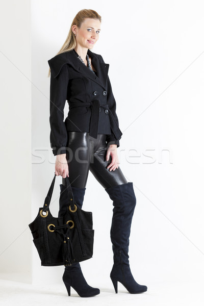 áll nő visel fekete ruházat kézitáska Stock fotó © phbcz