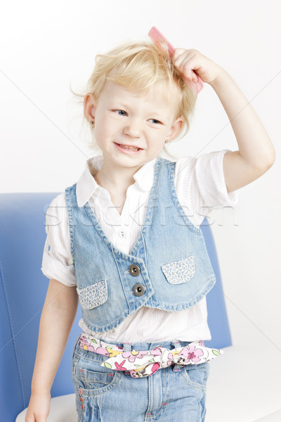 portrait of combing little girl Stock photo © phbcz