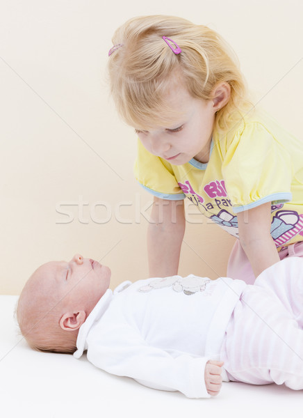 portrait of a little girl with her one month old baby sister Stock photo © phbcz