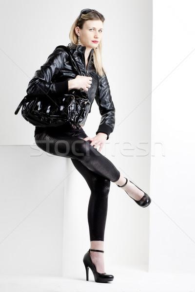 sitting woman wearing fashionable black clothes Stock photo © phbcz