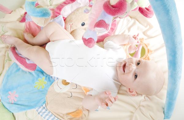 Kislány fekszik játszik gyerekek gyermek lányok Stock fotó © phbcz