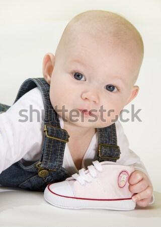Portré fekszik kislány tart cipők gyerekek Stock fotó © phbcz