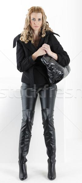 áll nő fekete ruházat kézitáska nők Stock fotó © phbcz