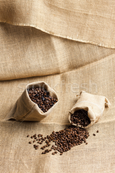 still life of coffee beans in jute bags Stock photo © phbcz
