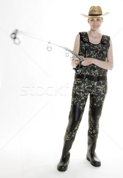 Rybak kobieta wędka studio kobiet połowów Zdjęcia stock © phbcz