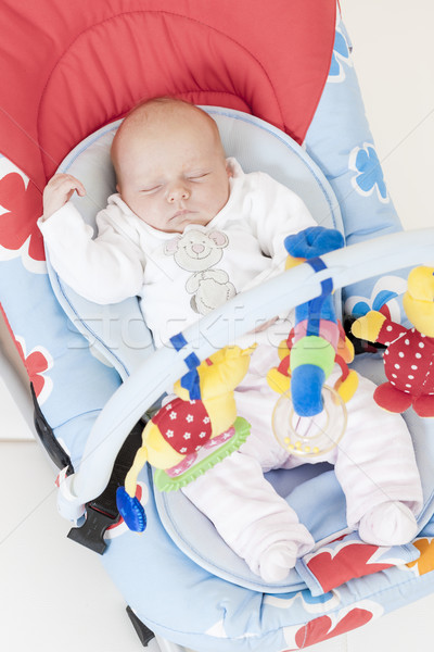 one month old baby girl sleeping in baby's chair Stock photo © phbcz