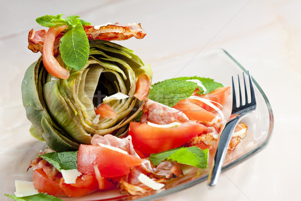 cooked artichoke with tomatoes, parmesan cheese, pancetta, and m Stock photo © phbcz