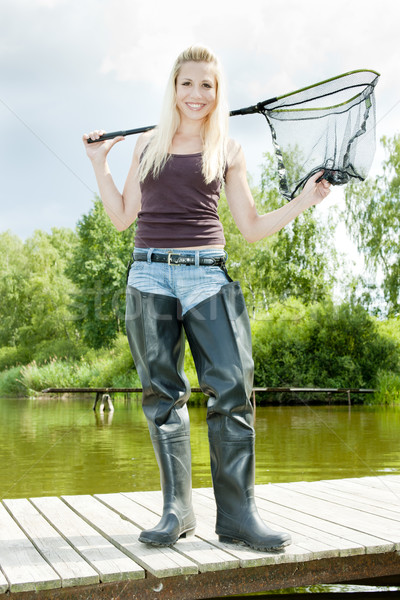 fishing woman with landing net standing on pier Stock photo © phbcz