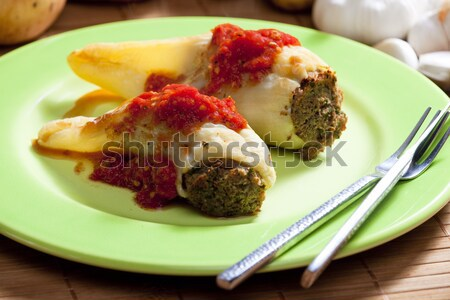 peppers filled with smoked meat and celery tops with tomato sauc Stock photo © phbcz