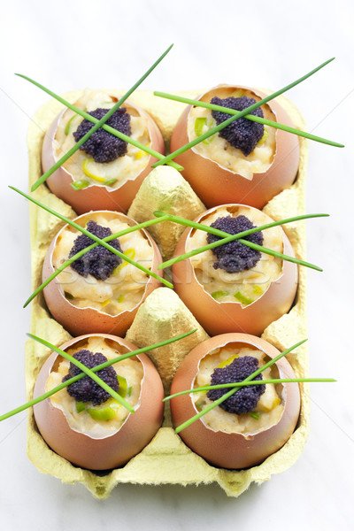 scrambled eggs with chives and black caviar Stock photo © phbcz