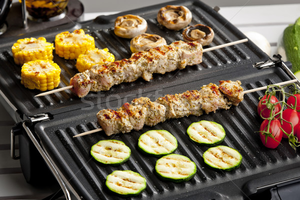 meat skewers and vegetables on electric grill Stock photo © phbcz
