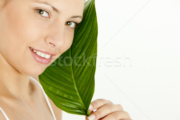Stock photo: portrait of young woman holding a leaf