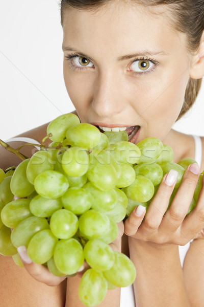 portrait of young woman with grape Stock photo © phbcz