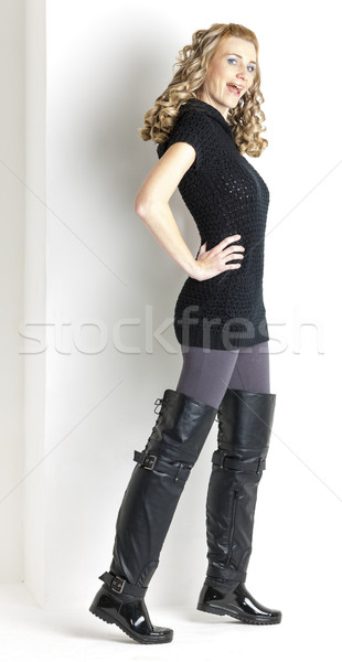 standing woman wearing black clothes and black boots Stock photo © phbcz