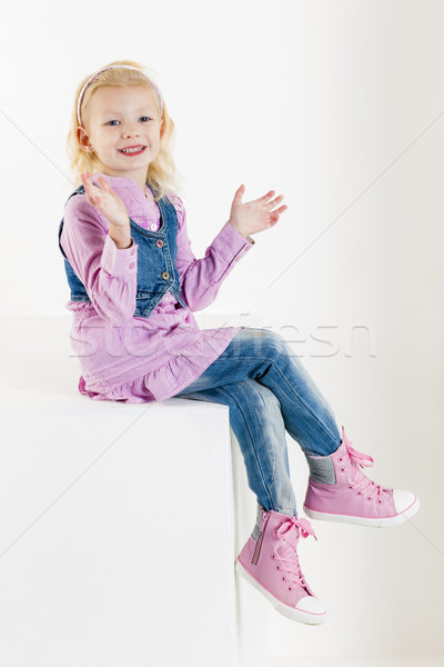 sitting little girl wearing jeans Stock photo © phbcz