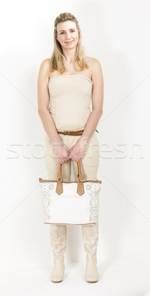 standing woman wearing summer clothes and boots witha a handbag Stock photo © phbcz