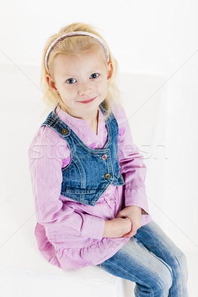 portrait of sitting little girl wearing jeans Stock photo © phbcz