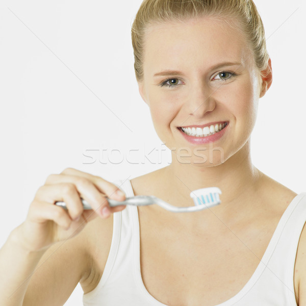 woman with toothbrush Stock photo © phbcz
