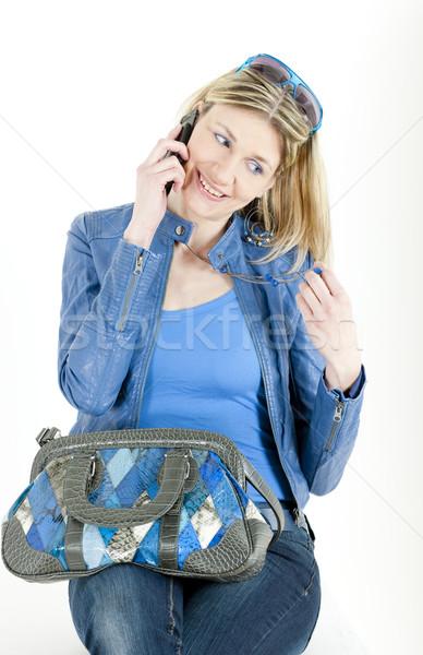 Portrait séance femme téléphone portable sac à main téléphone Photo stock © phbcz