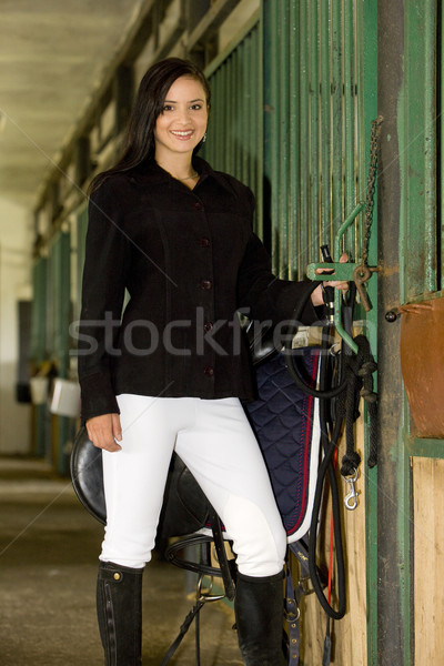 equestrian with saddle in a stable Stock photo © phbcz