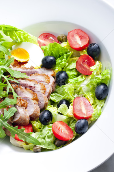 Stock photo: vegetable salad with fried duck breast slices and egg