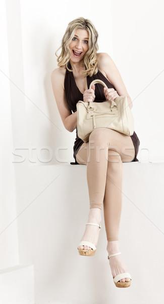 сидят женщину лет одежды обувь Сток-фото © phbcz