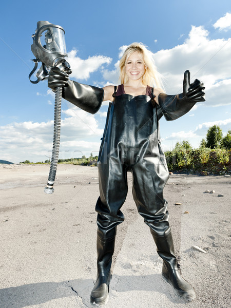 standing woman with gas mask wearing protective clothes Stock photo © phbcz