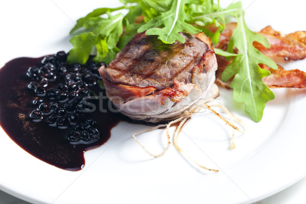 beefsteak grilled in bacon with sauce of juniper and red wine Stock photo © phbcz