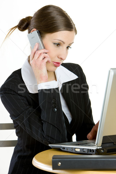 telephoning businesswoman with a laptop Stock photo © phbcz