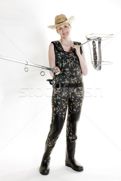 Pêcheur femme canne à pêche net studio femmes Photo stock © phbcz