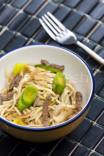 Asian noodles with beef meat and leek Stock photo © phbcz