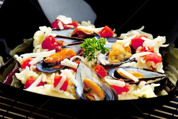 Stock photo: pasta with mussels and chopped tomatoes
