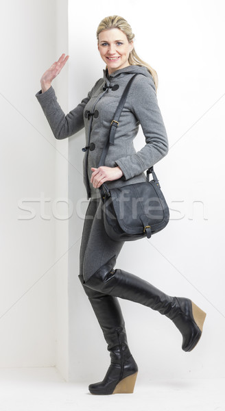 Nő visel vágány fekete csizma kézitáska Stock fotó © phbcz