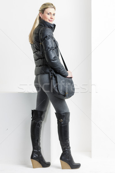 woman wearing platform black boots with a handbag Stock photo © phbcz