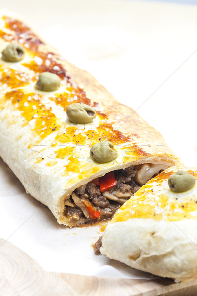 puff roly-poly filled with minced meat and green olives Stock photo © phbcz