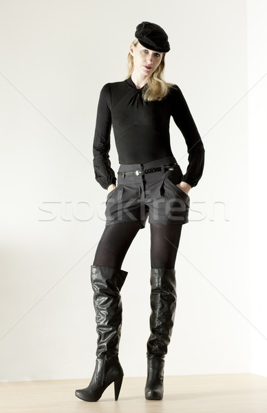 standing woman wearing fashionable boots Stock photo © phbcz