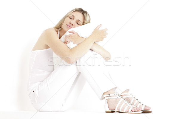 relaxing and sitting woman wearing white clothes and sandals Stock photo © phbcz
