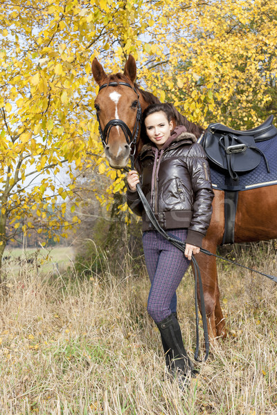 equestrian with her horse on autumnal meadow Stock photo © phbcz