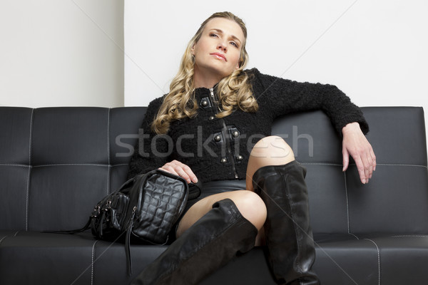 woman wearing black clothes with a handbag sitting on sofa Stock photo © phbcz