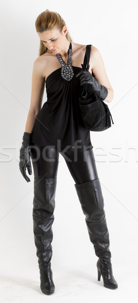 Stehen Frau tragen schwarz Kleidung Handtasche Stock foto © phbcz