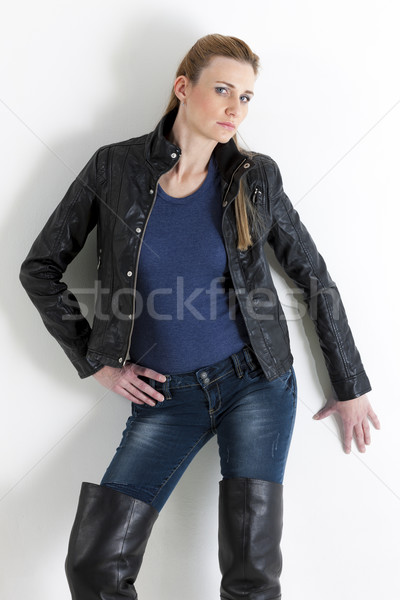portrait of standing woman wearing jeans and black jacket Stock photo © phbcz