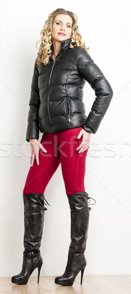 standing woman wearing fashionable clothes with black boots Stock photo © phbcz