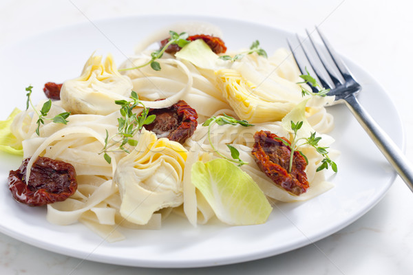 pasta with dried tomatoes and artichokes Stock photo © phbcz