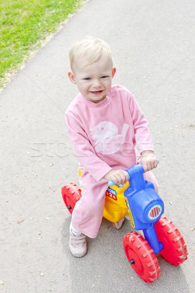 little girl on toy motorcycle Stock photo © phbcz