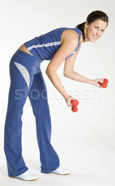 woman exercising with dumb bells Stock photo © phbcz