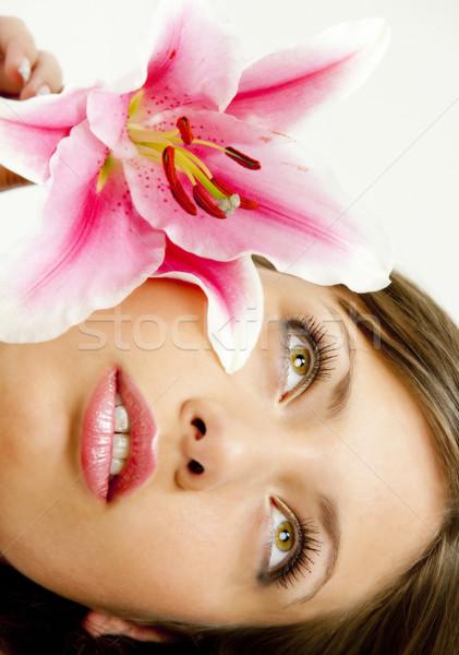 Retrato mulher jovem lírio mulher flores jovem Foto stock © phbcz