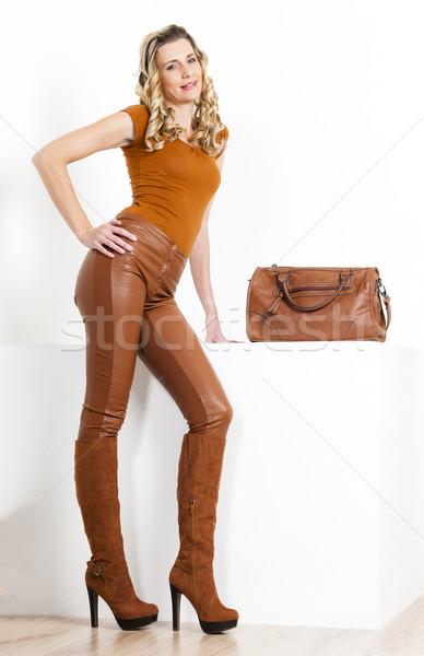 Постоянный женщину коричневый одежды сапогах Сток-фото © phbcz