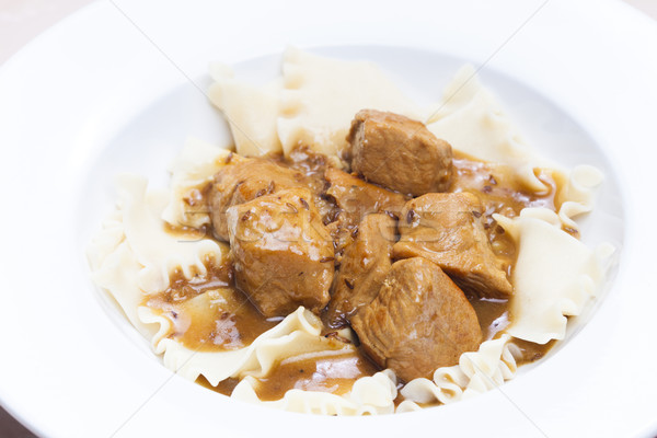 pork pieces on cumin with pasta Stock photo © phbcz
