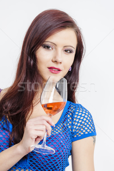 portrait of young woman with a glass of rose wine Stock photo © phbcz