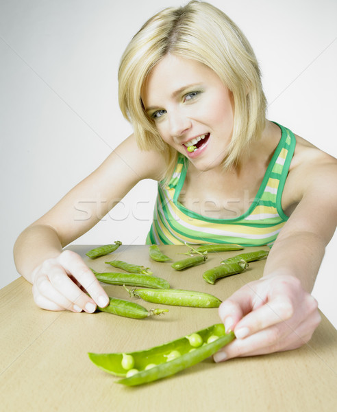 woman with pea pods Stock photo © phbcz